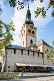 Banska Bystrica - Stary kasztel z barbakanem i zegarowy wierza Zdjęcia Stock