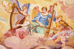 Banska Stiavnic - detail of fresco on cupola in the middle church of baroque calvary by Anton Schmidt . Angels with the music ins. BANSKA STIAVNICA, SLOVAKIA royalty free stock photography
