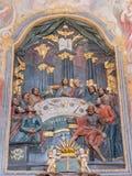Banska Stiavnica -最后的晚餐和法坛被雕刻的多彩安心在从18的更低的受难象教会里 分 由未知的艺术家 库存图片