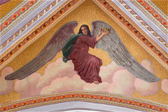 Banska Stiavnica - The angel with the hart with the flames on the ceiling of parish church from year 1910 by P. J. Kern. Stock Image