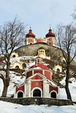 Banska Stiavnica baroque calvary, central and upper church with some chapels visible, winter season of march 2018. Cloudy skies Stock Image