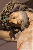 Banska Stiavnica - The detail of carved statue of Christ on the cross as the part of baroque Calvary from years 1744 - 1751. BANSKA STIAVNICA, SLOVAKIA Stock Image