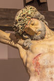 Banska Stiavnica - The detail of carved statue of Christ on the cross as the part of baroque Calvary from years 1744 - 1751. Royalty Free Stock Photography