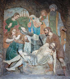 Banska Stiavnica - detail stone relief of Burial of Jesus as the part of baroque Calvary from years 1744 - 1751. Royalty Free Stock Image