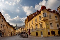 Banska Stiavnica, Slovakia - march 24, 2019 : old street and square in historical mining city of Banska Stiavnica. Banska Stiavnica, Slovakia -  march 24, 2019 royalty free stock images
