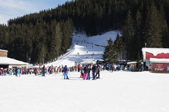Bansko, Bulgaria,  January 27, 2016:  Bansko ski station, cable car lift and people waiting in line near it in Bansko, Bulgaria. S Royalty Free Stock Image