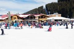 Bansko, Bulgaria, January 27, 2016:  Bansko ski station, cable car lift and people waiting in line near it in Bansko, Bulgaria. Sn Stock Photos
