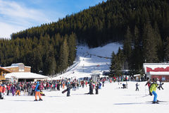 Bansko, Bulgaria, January 27, 2016:  Bansko ski station, cable car lift and people waiting in line near it in Bansko, Bulgaria. Sn Royalty Free Stock Photo