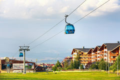 Bansko cable car cabin in summer, hotel houses and mountains, Bulgaria Stock Photo