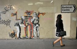 Bansky graffiti pracują na ulicach Londyn, Anglia Fotografia Stock