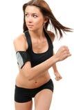 banta den rustande running kvinnan för idrottshallen Arkivbilder