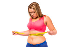 banta fet kvinna arkivfoto