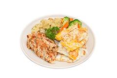 Banta mat, rengöringen som äter, feg biff och omelettet med grönsaken Arkivfoto