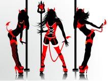 banta s-silhouetteskvinnor Arkivbild