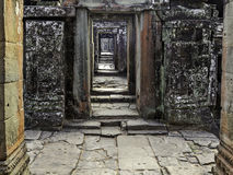 Bantaey Kdei corridor. View along corridor of ruined temple through multiple doorways royalty free stock images
