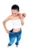 Bantar förlorande vikt för den asiatiska kvinnan med Royaltyfri Foto