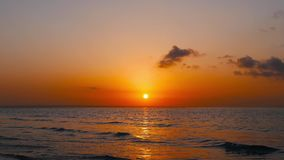 Bantayan sunrise. A colorful, high tide, Bantayan Island sunrise video. The sun is higher above the horizon stock video footage