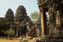 Banteay Kdei carved apsara and entrance to central temples. Towers on the background Royalty Free Stock Image