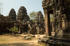 Banteay Kdei carved apsara and entrance to central temples. View from easte to west Royalty Free Stock Image