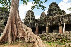 Banteay Kdei with tree roots Royalty Free Stock Photos