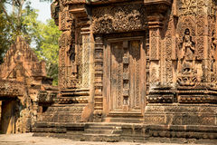 Banteay Srei door. Banteay Srei stone door with carving details Stock Image