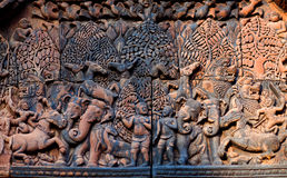 Banteay Srey Temple, Cambodia. Ancient bas-relief at the facade of Banteay Srey Temple in Angkor Area, Cambodia. Banteay Srey is a 10th century Cambodian temple Royalty Free Stock Image