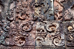 Banteay Srey Temple, Cambodia. Ancient bas-relief at the facade of Banteay Srey Temple, Cambodia. Banteay Srey is a 10th century Cambodian temple dedicated to Royalty Free Stock Photo