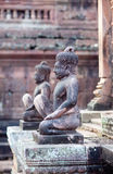 Banteay Srey Temple, Cambodia. Ancient statues in famous Banteay Srey Temple in Angkor Area, Cambodia. Banteay Srey is a 10th century Cambodian temple dedicated Royalty Free Stock Photo