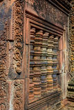 Banteay Srey. The window of the hinduistic Banteay Srey Temple at the Angkor Wat area dates back to the 10th century and is dedicated to Shiva Royalty Free Stock Photos