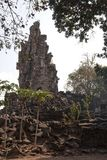 Iew of the damaged tower at the Banteay Top temple. Banteay Top or Fortress of the Army, is a small temple with tall, damaged towers. Believed to be a tribute to Stock Images