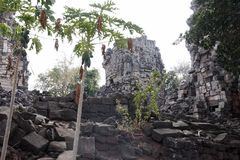Banteay Top, view of the damaged temple. Banteay Top or Fortress of the Army, is a small temple with tall, damaged towers. Believed to be a tribute to the army Royalty Free Stock Images