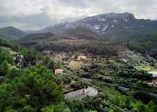 Banyalbufar town surrounded by Tramuntana mountains. Majorca, Spain stock photography