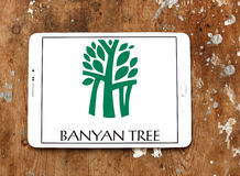 Banyan tree hotels logo. Logo of hotels chain banyan tree on samsung tablet on wooden background royalty free stock photography