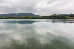 Banyoles Lake with cloudy sky in Spain. Stock Images