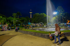 BANYUWANGI, INDONESIA: Charming park area with green vegetation and popular water fountain, people enjoying, beautiful. Blue evening sky in background Stock Photography