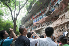 Bao Ding Mountain Circle of Life. The Dazu Rock Carvings (Chinese: 大足石刻; pinyin: Dàzú Shíkè) are a series of Chinese religious sculptures and stock photography