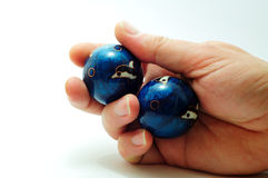 Baoding balls in hand. A pair of baoding balls in the hand Stock Images