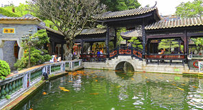 Baomo garden koi pond and pagoda with walkway. Visitors relaxing and enjoying the peaceful moments at the baomo garden. location : guangzhou, china Royalty Free Stock Photography