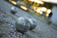 Baoule laying on gravel.JH. Three boules on a gravel playground stock photos