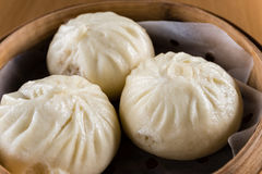 Baozi. Chinese characteristics of the steamed stuffed bun Stock Photos