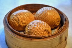 Baozi, chinese yeast dumplings with different fillings. Walnut yeast dumplings. Dim sum is a style of Chinese cuisine particularly Cantonese prepared as small stock photo