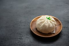 Baozi dim sum. Baozi or bao dim sum on plate with copy space on dark background stock images