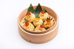 Baozi or munsun, or simply bao - a popular Chinese dish, which is a small pie, steamed. Isolated Royalty Free Stock Image
