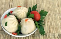 Baozi stuffed with meat. Three baozi stuffed with meat in a bowl Stock Image