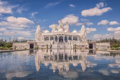 Reflection of the BAPS Shri Swaminarayan Mandir Houston in the p stock photos