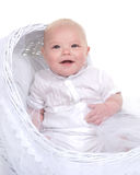 Baptism. Beautiful baby boy smiling wearing his Christening outfit in the studio Royalty Free Stock Photo