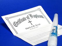 Baptism. Certificate and candle stock image