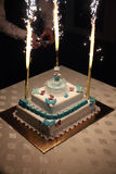Baptism cake decorated with blue fondant objects Stock Photography