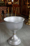 The baptism of a child in the Orthodox Church. Chan for ablution. Stock Images