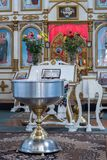 Baptism of a Child in the Ukrainian Orthodox Church. Lord`s table and big bowl of water for the baptism of a baby. royalty free stock photo